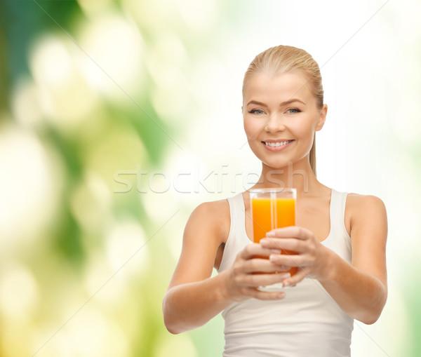 улыбающаяся женщина стекла апельсиновый сок продовольствие здравоохранения Сток-фото © dolgachov