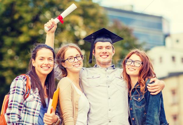 Stock fotó: Diákok · tinédzserek · akták · diploma · oktatás · kampusz