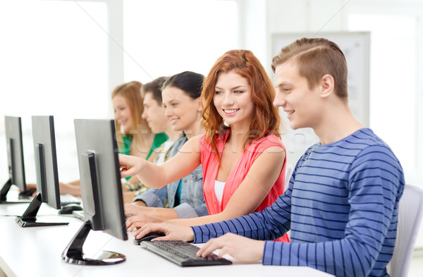 female student with classmates in computer class Stock photo © dolgachov