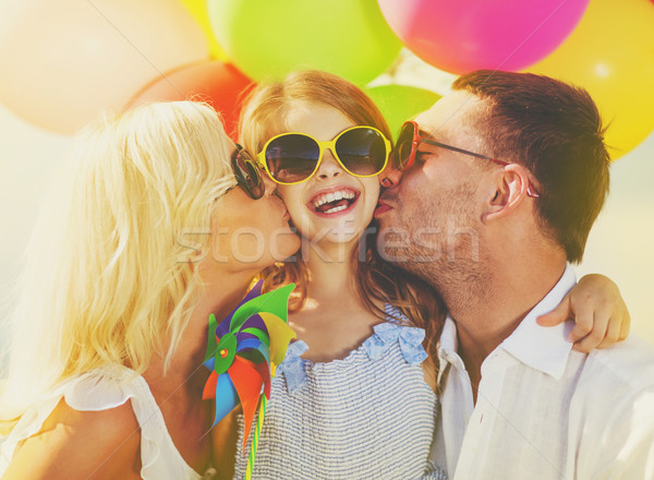 Stock photo: family with colorful balloons