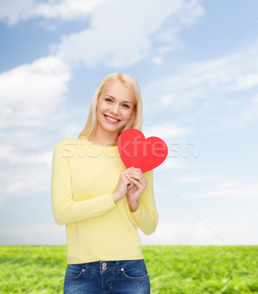 Stock photo: smiling woman with red heart