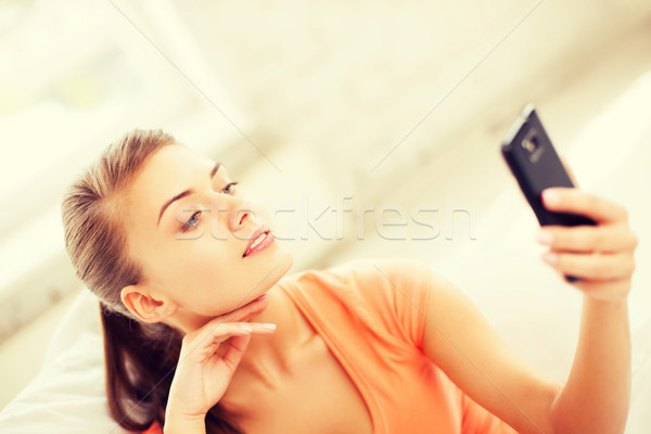 woman making self portrait with smartphone Stock photo © dolgachov