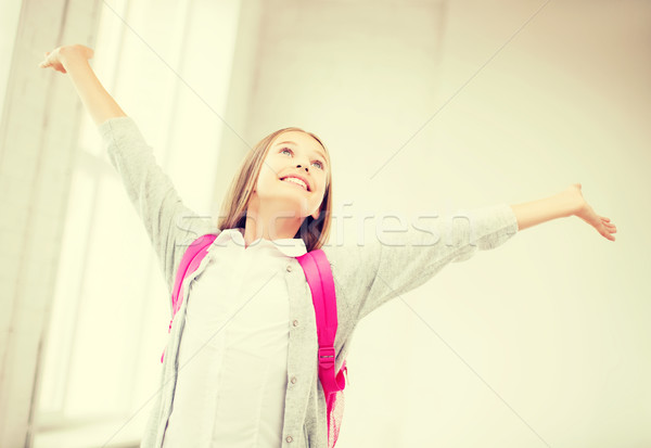 happy teenage girl with raised hands Stock photo © dolgachov