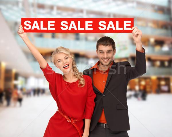 Mosolyog pár piros vásár felirat karácsony Stock fotó © dolgachov