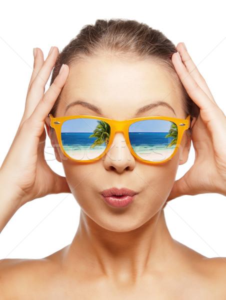 amazed teenage girl in sunglasses Stock photo © dolgachov