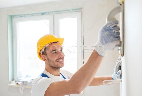Uśmiechnięty budowniczy pracy narzędzie budynku Zdjęcia stock © dolgachov