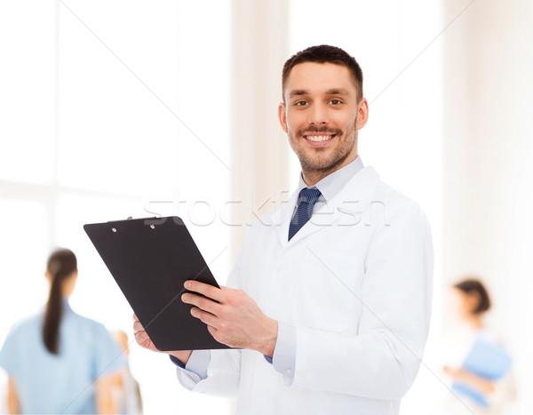 Sorridente médico do sexo masculino clipboard medicina profissão saúde Foto stock © dolgachov