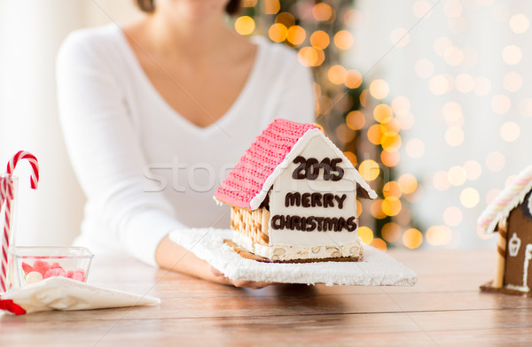 close up of woman showing gingerbread house Stock photo © dolgachov