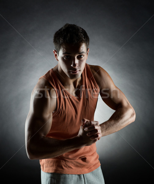 young man showing biceps Stock photo © dolgachov