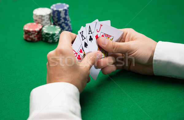 poker player with cards and chips at casino Stock photo © dolgachov