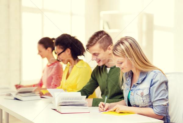 Stock fotó: Diákok · tankönyvek · könyvek · iskola · oktatás · öt
