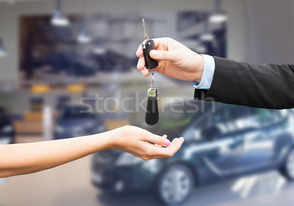 close up of customer and salesman with car key Stock photo © dolgachov