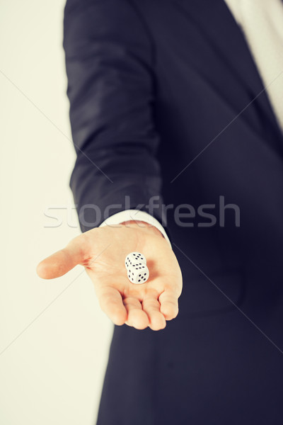 mans hand holding white casino dice Stock photo © dolgachov