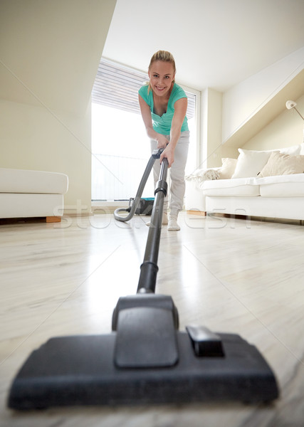 happy woman with vacuum cleaner at home Stock photo © dolgachov