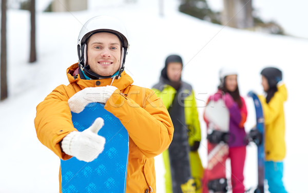 happy young man with snowboard showing thumbs up Stock photo © dolgachov