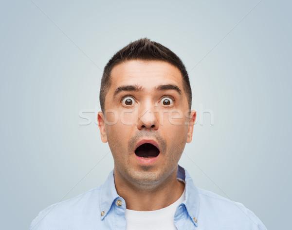scared man shouting Stock photo © dolgachov