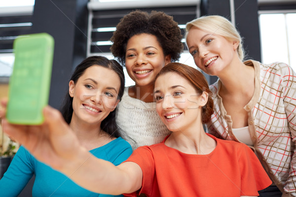Stock photo: happy young women taking selfie with smartphone