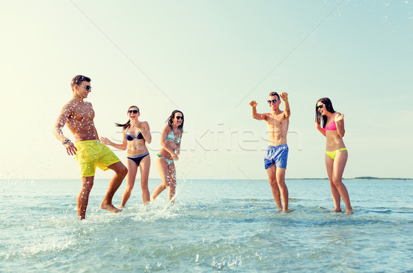 Stock photo: happy friends having fun on summer beach
