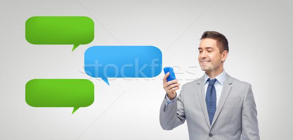 Сток-фото: счастливым · бизнесмен · сообщение · смартфон · деловые · люди