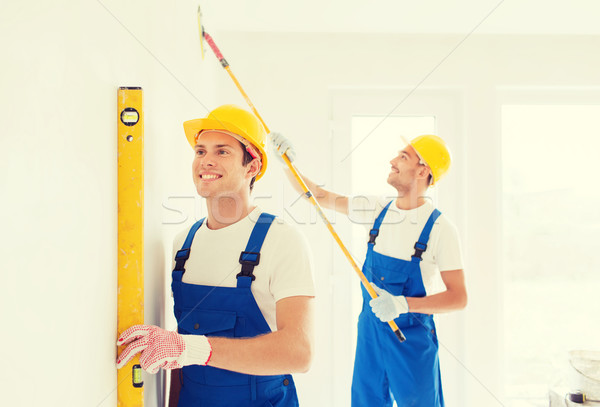group of builders with tools indoors Stock photo © dolgachov