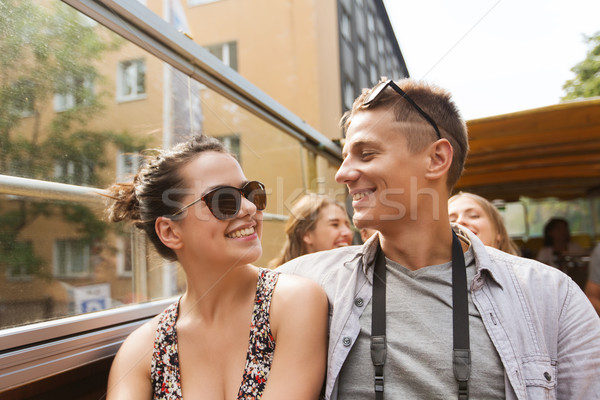 smiling couple traveling by tour bus Stock photo © dolgachov
