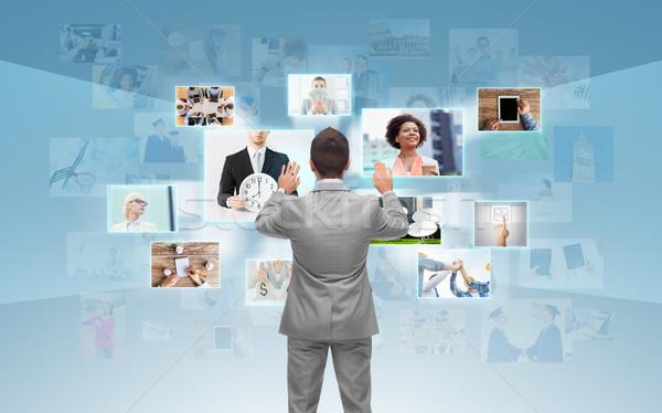 businessman working with virtual screen Stock photo © dolgachov