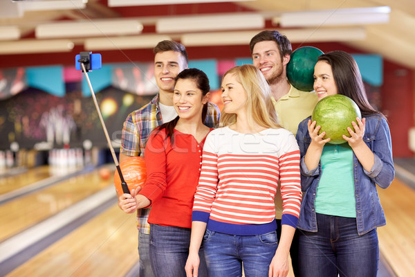 happy friends taking selfie in bowling club Stock photo © dolgachov