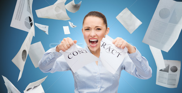 angry businesswoman tearing contract Stock photo © dolgachov
