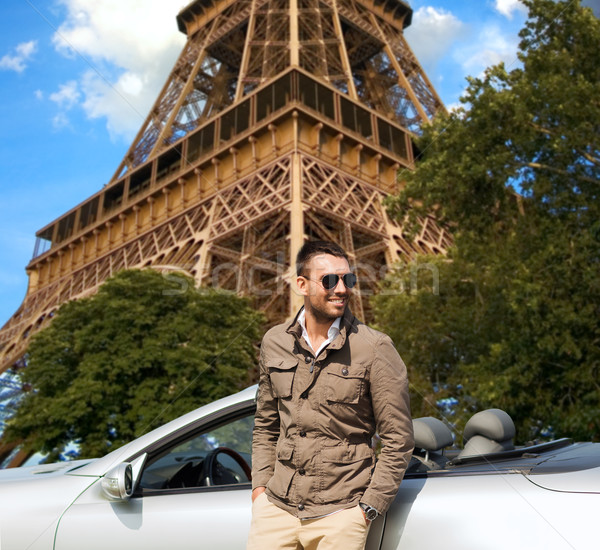 Mutlu adam kabriyole araba Eyfel Kulesi seyahat Stok fotoğraf © dolgachov