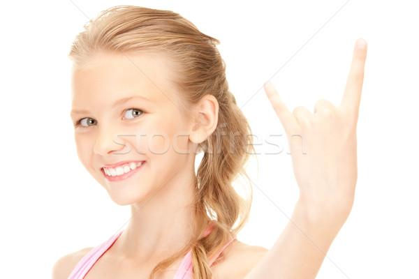 happy girl showing devil horns gesture Stock photo © dolgachov