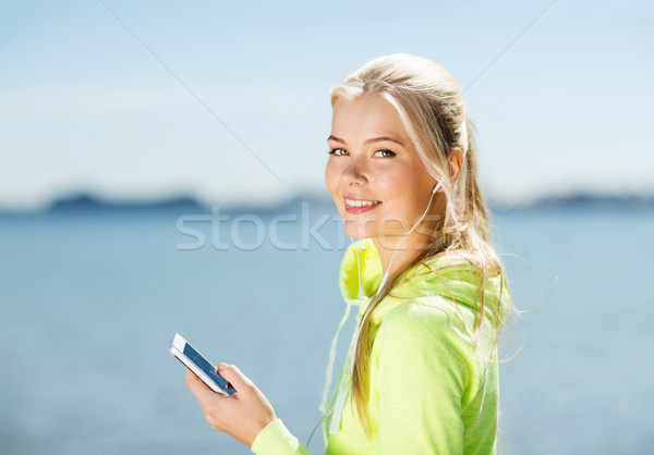 Stock photo: woman listening to music outdoors
