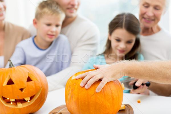 family making lantern of pumpkins for helloween Stock photo © dolgachov
