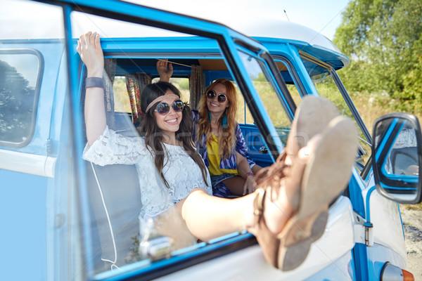 smiling young hippie women resting minivan car Stock photo © dolgachov