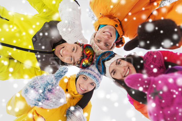 happy friends in winter clothes outdoors Stock photo © dolgachov