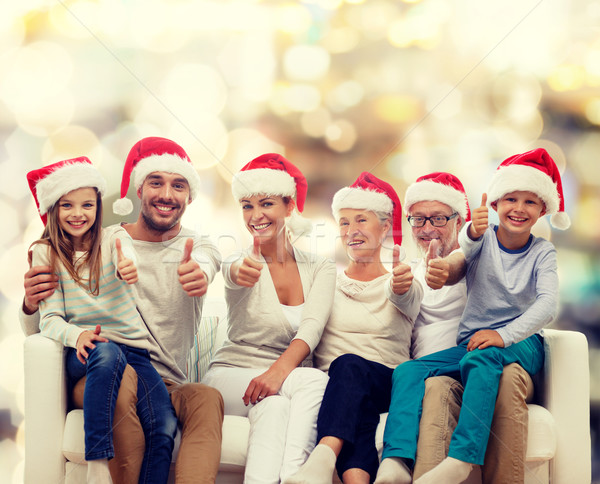happy family sitting on couch Stock photo © dolgachov