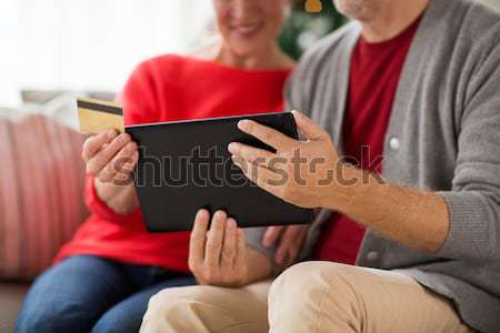 close up of lesbian couple with tablet pc at home Stock photo © dolgachov