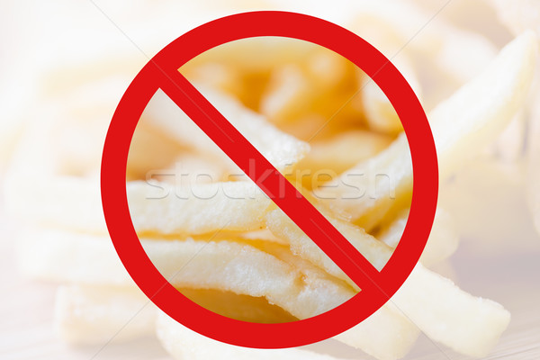 close up of french fries behind no symbol Stock photo © dolgachov