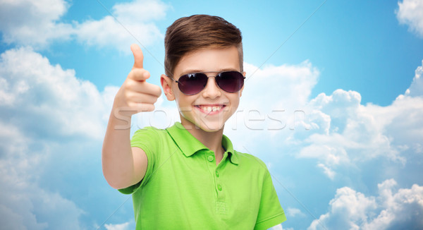 smiling boy in sunglasses and green polo t-shirt Stock photo © dolgachov