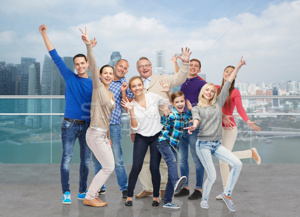 happy people having fun over city waterside Stock photo © dolgachov