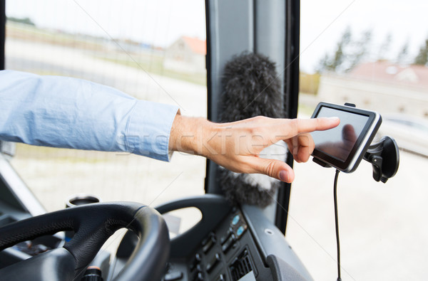 close up of bus driver driving with gps navigator Stock photo © dolgachov