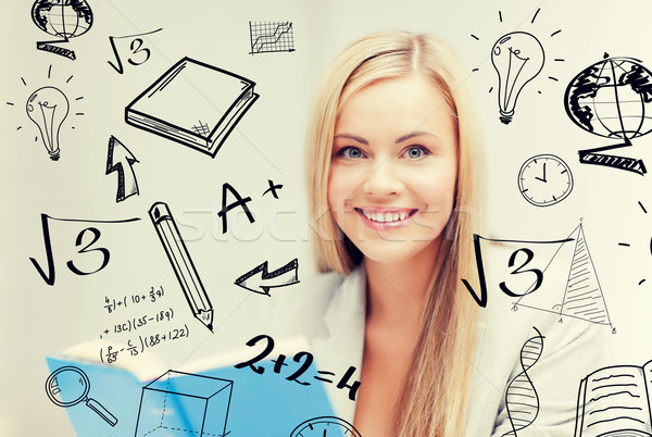 student with doodles reading book Stock photo © dolgachov
