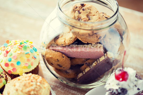 close up of cupcakes, cookies and muesli bars Stock photo © dolgachov