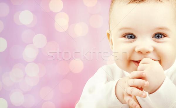 happy baby over pink lights background Stock photo © dolgachov