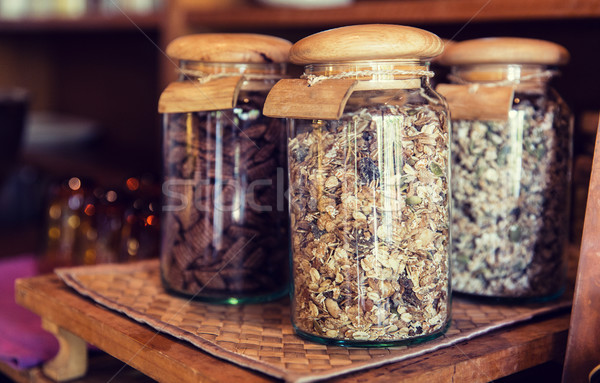 close up of jars with granola at grocery store Stock photo © dolgachov