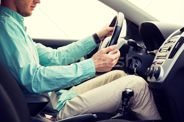 человека смартфон вождения автомобилей транспорт Сток-фото © dolgachov