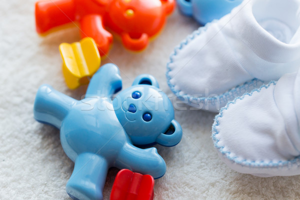 close up of baby rattle and bootees for newborn Stock photo © dolgachov