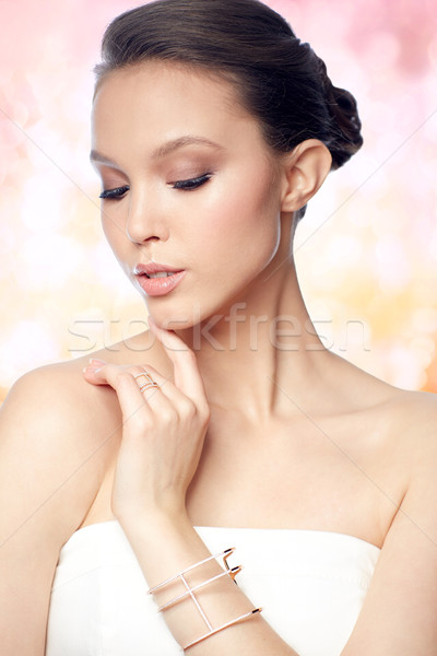 beautiful asian woman with ring and bracelet Stock photo © dolgachov