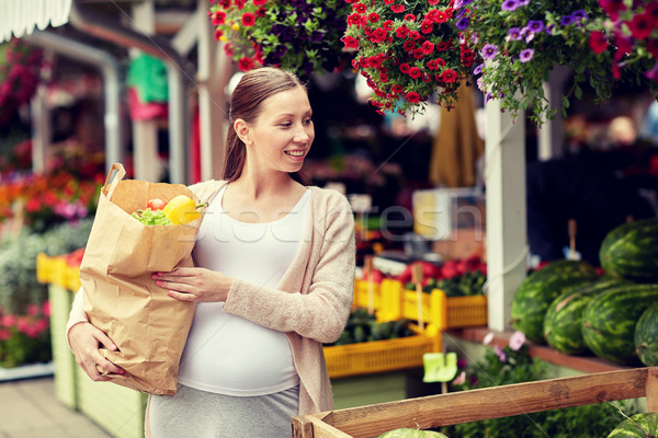 pregnant woman with bag of food at street market Stock photo © dolgachov