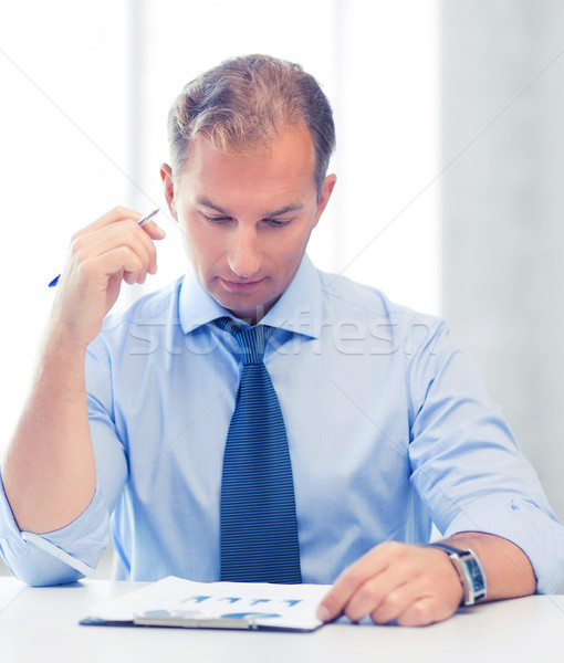 businessman writing in notebook Stock photo © dolgachov