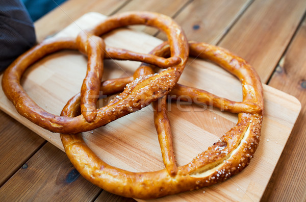 Deux bretzels table en bois alimentaire Photo stock © dolgachov